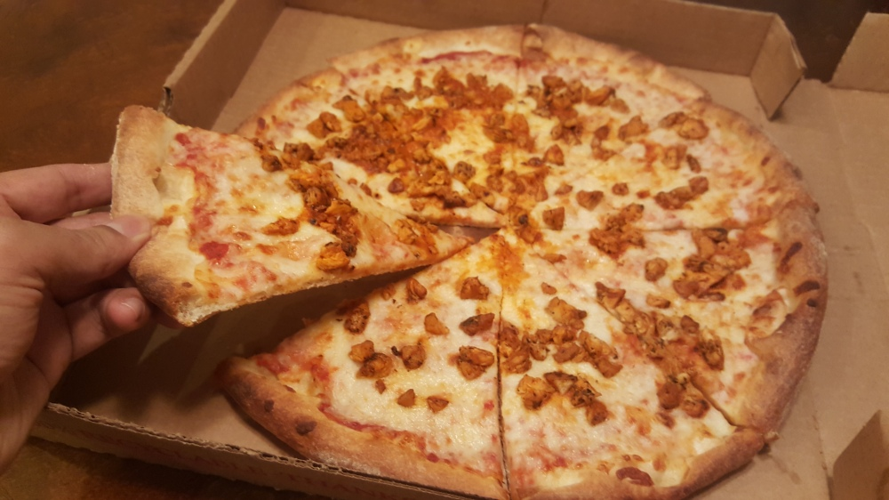 large pizza with buffalo chicken